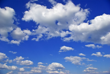 The white clouds against the pure blue sky
