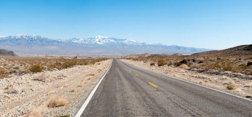 Road passing through landscape, Death Valley National Park, Cali