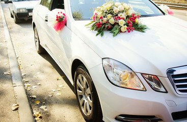 Flowers by the wedding car