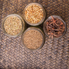 Spices and herb varieties over a wicker background