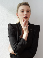 portrait of the beautiful young fashionable girl in studio posin