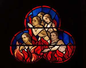 Fototapete - Stained glass window of people burning in hell