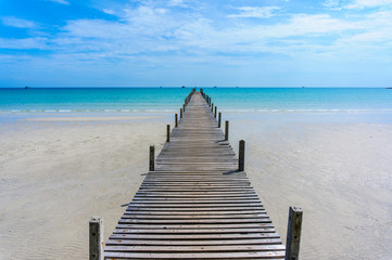Wooden pier with blue sea and sky background Wall mural