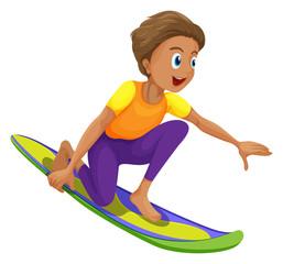 A boy surfing