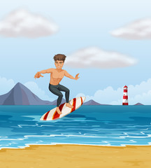 A boy surfing at the beach