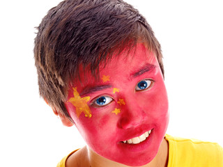 chinese flag painted on boy's face