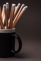 Simple pencils in a black mug