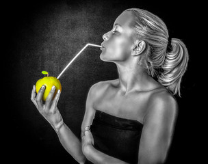 Monochrome photo of a woman drinking an apple