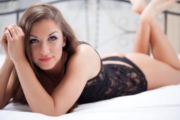 portrait of beautiful woman in underwear lying on the bed