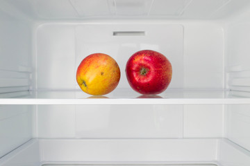 Apples in open empty refrigerator  Weight loss diet concept