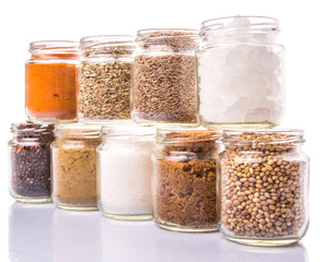 Different variety of sugar and spices over white background