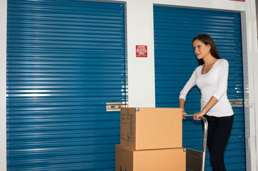 Pretty Woman Moving Cart Full Cardboard Boxes Storage Facility