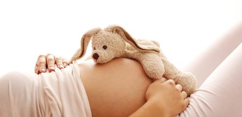 Obraz pregnant woman on a white background - fototapety do salonu
