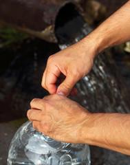 Male hands closed water bottle