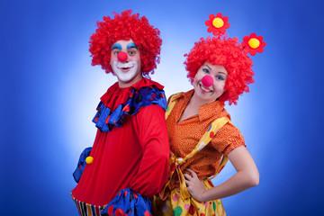 Clowns on blue background studio shooting
