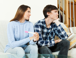 worried woman with pregnancy test