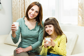 Glass of milk for mother and daughter