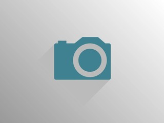 Flat long shadow icon of a camera