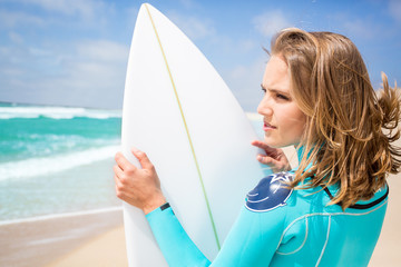 Surfer woman on the beach
