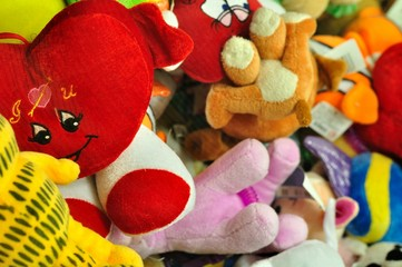 Pile of colorful stuffed animal toys for a childs