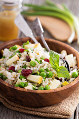 Salad with rice, apple, cranberry and peas