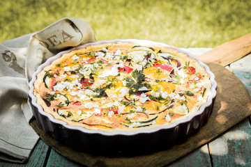 Tasty vegetarian quiche on a summer picnic