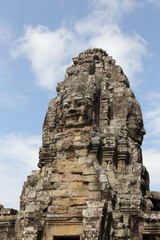 stone face of bayon temple in angkor thom cambodia