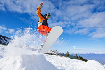 Jumping snowboarder from hill in winter Wall mural
