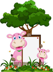 Cute hippo cartoon with blank sign in garden