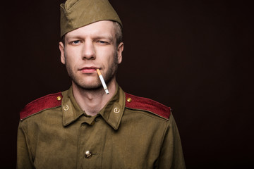 Russian soldier smoking cigarette