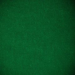 green fabric textile material as texture or background