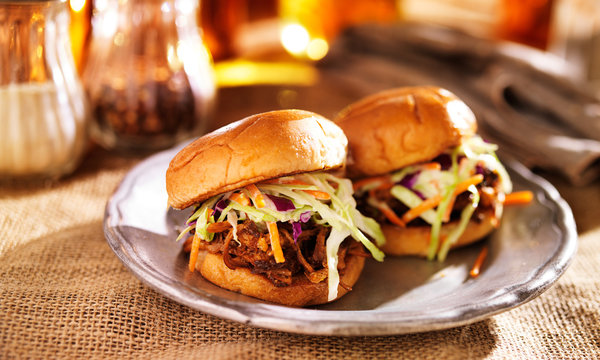 pulled pork sandwiches with bbq sauce and slaw