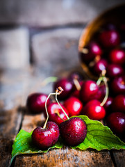 Cherries on rustic wooden background