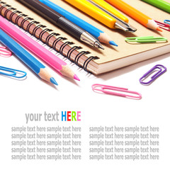 notebook and color pencils stationery isolated on white backgrou
