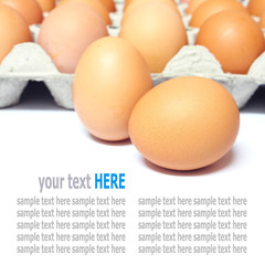Fresh eggs in the package isolated on white background