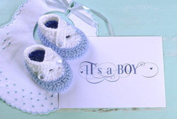 Baby boy bib and booties with its a boy card