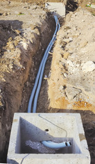 Corrugated pipes underground to connect two inspection wells