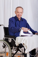 Disabled man during ironing