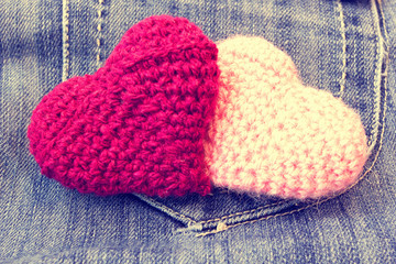 knitted valentine's hearts on a vintage jeans background