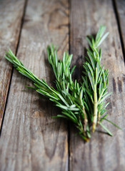 fresh rosemary bunch on an old rustic wooden table