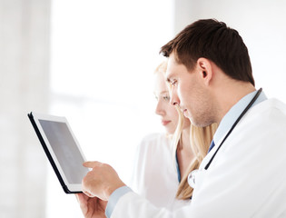 two doctors looking at x-ray on tablet pc