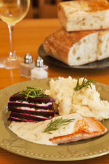 organic salmon in dill sauce with mashed potatoes,beets,wine