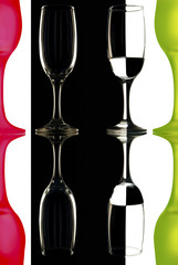 glass wine glasses on black and white background with reflection