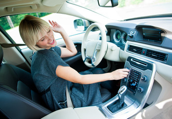 attractive woman listen radio in her car