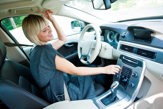 attractive woman listen radio in her car