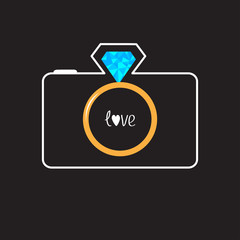 Photo camera with gold wedding ring lens. Diamond flash. Love ca