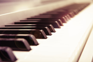 Selective focus of a piano keyboard keys retro style