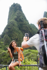 Couple taking photos having fun lifestyle, Hawaii