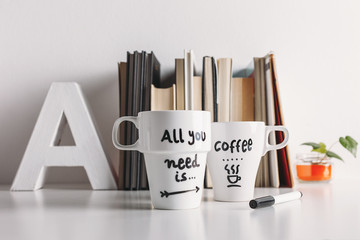 Two white coffee mug with diy decoration.