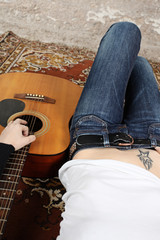 Woman with a acoustic guitar